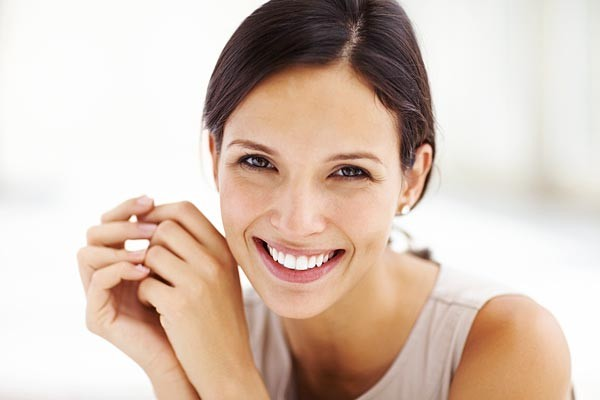 A woman smiling at camera with white background